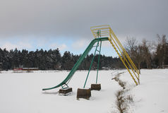 Abandoned slide on frozen lake in winter Royalty Free Stock Photo