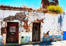 Abandoned Small House with Green Bush on Old Red Tile Roof Royalty Free Stock Photography