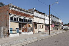 Abandoned Small Town Main Street. Abandoned dilapidated buildings of main street of small town in the American midwest with U.S. flag flying Royalty Free Stock Image
