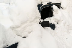 Abandoned Snow Covered Car Stuck in Winter Blizzard Stock Photo