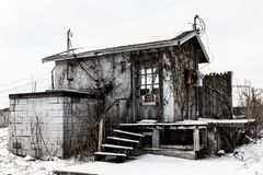 Abandoned snow covered electrical shack - Worn, Broken and Forgotten I stock images