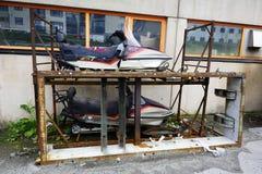 Abandoned snowmobiles Stock Photos