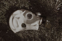 Abandoned Soviet gas mask on  grass in a retro style Stock Photos