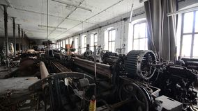 Abandoned spinning in factory with wind stock footage