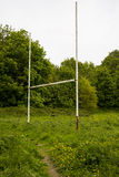 Abandoned sports ground. Old rugby posts on disused royalty free stock photos