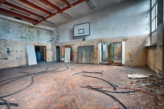 Abandoned sports hall in a devastated building. Forgotten gym in a ruined building royalty free stock photography