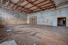 Abandoned sports hall in a devastated building Stock Photos