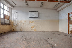 Abandoned sports hall in a devastated building Royalty Free Stock Photo