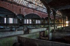 Abandoned stabling for cattle in German slaughterhouse Rosenau.  Royalty Free Stock Images