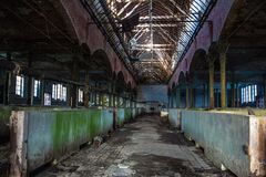 Abandoned stabling for cattle in German slaughterhouse Rosenau.  Royalty Free Stock Photography