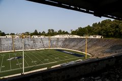 Abandoned Stadium - Rubber Bowl - University of Akron Zips - Akron, Ohio. An evening view of the abandoned Rubber Bowl stadium that was home to the University of Stock Photography