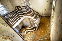 Abandoned Staircase. Interior shot of staircase in an abonded house Royalty Free Stock Image
