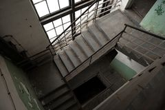 Abandoned stairs of an industrial building Stock Photo