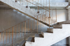 Abandoned stairs. Abandoned industrial concrete stairs interior royalty free stock image