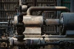 Abandoned steam engine in old rice mill. Abandoned steam engine in an old Thai rice mill stock photos