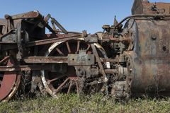 Abandoned steam locomotive in the countryside. Abandoned steam locomotive parts in the countryside Stock Photography