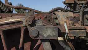 Abandoned steam locomotive in the countryside. Abandoned steam locomotive parts in the countryside Royalty Free Stock Images