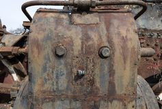 Abandoned steam locomotive in the countryside. Abandoned steam locomotive parts in the countryside Stock Images