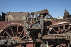 Abandoned steam locomotive in the countryside. Abandoned steam locomotive parts in the countryside Stock Photo