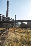 Abandoned steel works full of died grass. Located in Beijing, stop service in 2008 Royalty Free Stock Image