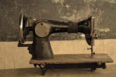 Abandoned stitching machine Stock Images