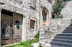 Abandoned stone built houses in old, mediterranean town. A stairway through historic, mediterranean town Šibenik with abandoned stone houses Royalty Free Stock Photos