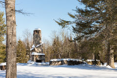 Abandoned Stone Chimney in Winter Woods Stock Photos