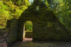 Abandoned Stone Structure covered with plants Royalty Free Stock Photo