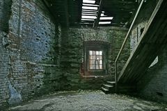 Abandoned store house. Hall with staircase royalty free stock image