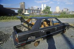An abandoned, stripped Volvo automobile near the Brooklyn Bridge in Brooklyn Stock Photography