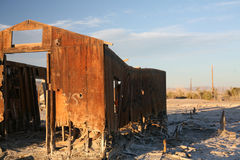 Abandoned structure at the Salton Sea. An abandoned wooden structure decays in the desert of the Salton Sea Stock Image