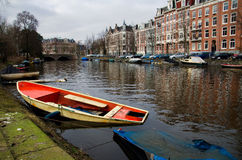 Abandoned sunken boats in Amsterdam Stock Images