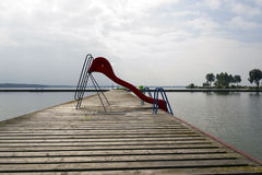 Abandoned swimming pool. With a slide into the water Stock Photography