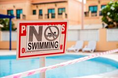 Free Abandoned Swimming Pool At The Time Of Epidemic. Health Measures. No Swimming Sign.Pool Under Closure. Consequences Of Self Royalty Free Stock Photos - 206846408