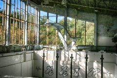 Abandoned swimming pool in Pripyat, the ghost town in the Chernobyl Exclusion Zone Royalty Free Stock Photography