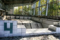 Abandoned swimming pool in Pripyat, the ghost town in the Chernobyl Exclusion Zone Stock Images