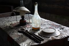 Abandoned table. With a old gas lamp Stock Image