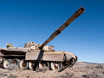 Abandoned tank in the desert. Military tank abandoned in the desert Stock Photos