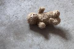 Abandoned Teddy Bear with cropped ears. Lost Teddy Bear with cropped ears on the basement floor Stock Images