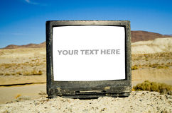 Abandoned Television. Broken and abandoned television set on a small hill in the desert Stock Photo