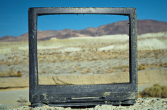 Abandoned Television. Broken and abandoned television set on a small hill in the desert Stock Photos