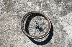 Abandoned Tire. Abandoned bicycle tire with metal spokes,on gravel or pavement Stock Images