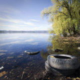 Abandoned tires on the lake of varese Stock Photography