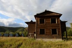 Abandoned tourist complex `Eldorado` at the mouth of the river Inya Altai Territory. ALTAI REGION, RUSSIA - SEPTEMBER 3, 2018: Abandoned tourist complex ` stock photography