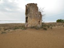 Abandoned Tower on Beach in Greece royalty free stock images