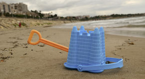 Abandoned toy shovel and bucket on the beach Stock Images