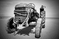 Abandoned tractor. Black and white picture of an old rusty tractor Royalty Free Stock Image