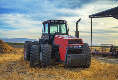 Abandoned Tractor on the Field. Sunset Royalty Free Stock Photo