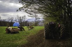 Abandoned tractor landscape in Serbian mountains. Concept of rural development stock image