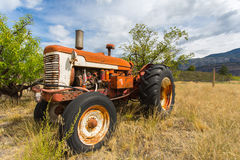 Abandoned tractor. Old abandoned tractor in grass field Royalty Free Stock Photography
